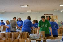 Volunteers packing snack kits for Washington Kids in Transition
